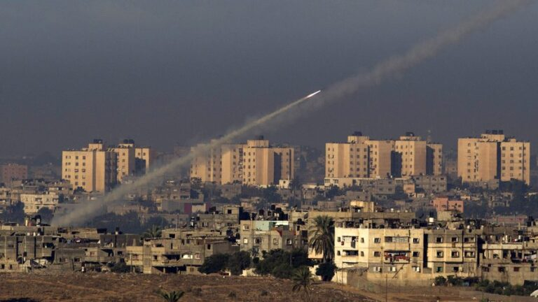 Palestinian militants fire a rocket from the northern Gaza Strip toward southern Israel.